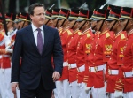 Prime Minister David Cameron inspects a guard of honour at the Presidential Palace in Jakarta.